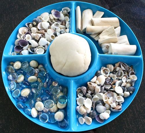 Exploring shells: This provocation uses shells and coconut scented natural playdough. The post also includes other explorations of shells. {from Fantastic Fun & Learning}