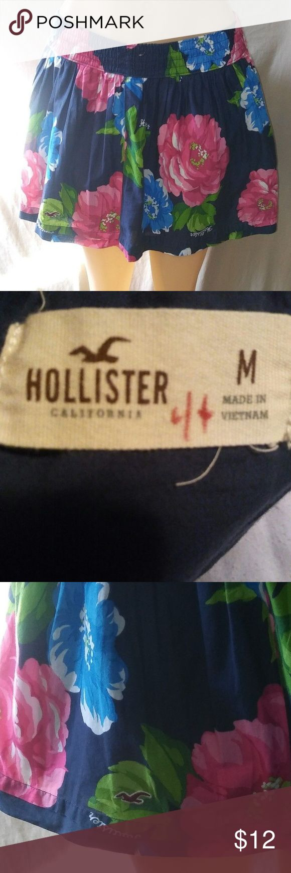 """Hollister California Size Medium Floral Skirt This is a pre-owned Hollister California short skirt. Has some fabric fade from washing. There is a number on the skirt tag. Waist un-stretched measures 26"""" Length of skirt from waist to hem is 14.5""""  Don't hesitate to send offers, will accept any reasonable offer. Hollister Skirts Mini"""