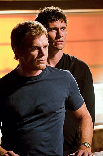 Michael C. Hall as Dexter and Christian Camargo as Rudy [aka Ice Truck Killer] Dexer's deceased Brother