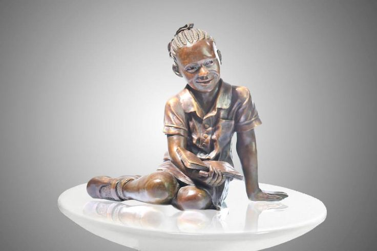 African school girl bronze figurative sculpture by James Cook