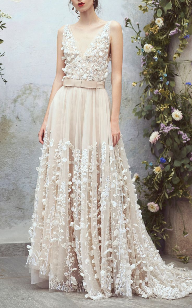 This Luisa Beccaria Organdy Floral Embroidered Ball Gown features a textured design and a plunging v-neckline.