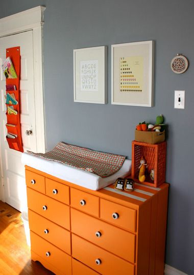 love the color of this dresser. glad i'm not the only one with a makeshift baby changing table!