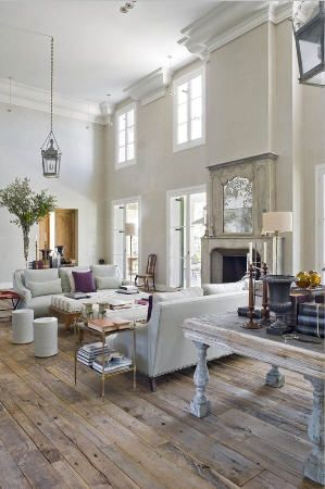 Repurposed flooring- love the tone on tone white.  Great way to decorate those new homes with tall ceilings.  Crown mold and the cast stone fireplace mantel with overmantel adds architectural detail.