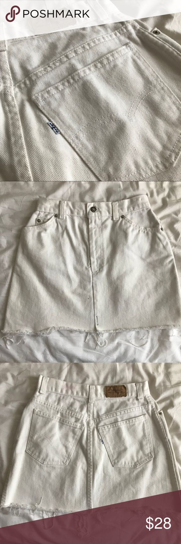 "Vintage Levi's White Denim Mini Skirt iconic Classic A-line fit, vintage white denim Levi's skirt with frayed hem. 2 minor stains pictured that could probably be removed with bleach or shout  Color:ivory/white denim Size:26"" around (no inside tags"" Length: 15"" Levi's Skirts Mini"