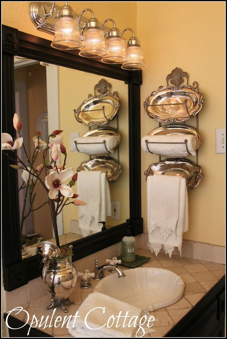 Totally repurposed bathroom from theOpulent Cottage. Wine racks, small silver trays, and a teapot vase.