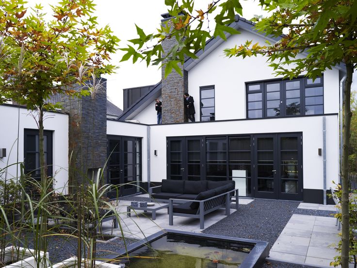 b & w inside and outside, always a good solution. I love the large black windows!