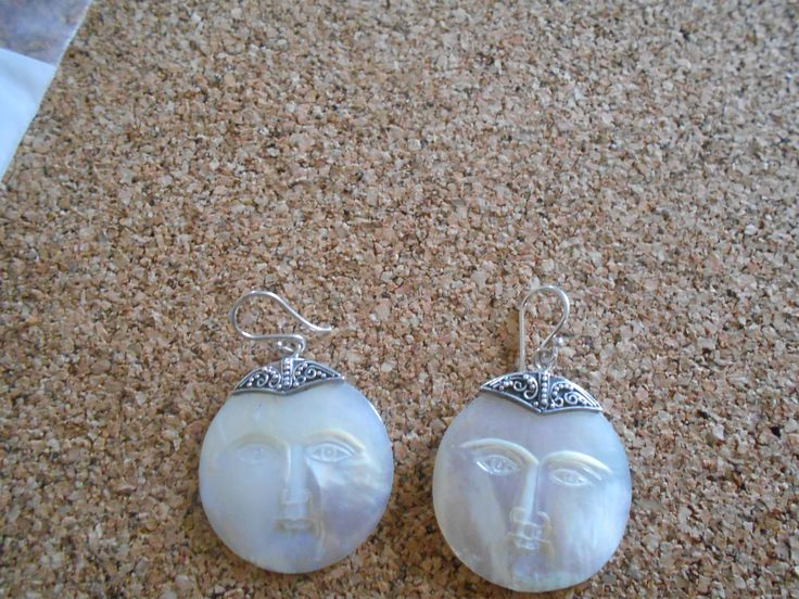 Carved mother of pearl earrings in sterling silver