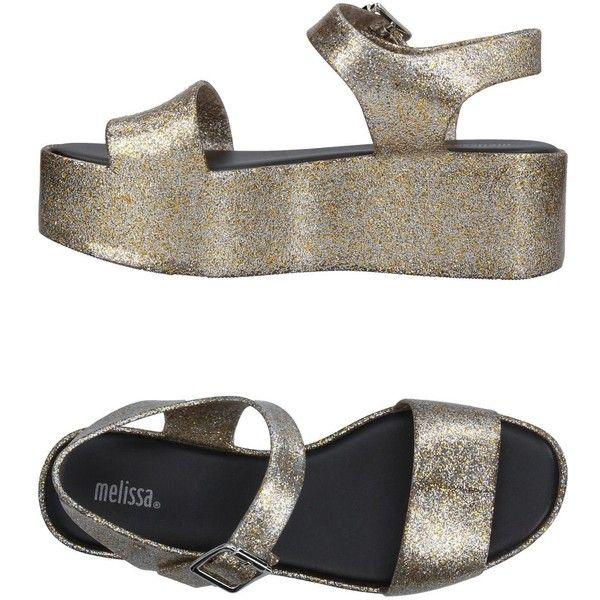 Melissa Sandals (390 BRL) ❤ liked on Polyvore featuring shoes, sandals, gold, wedge sandals, melissa sandals, round toe shoes, glitter wedge sandals and wedge heel sandals