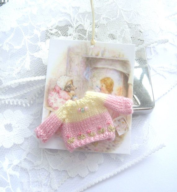 HERE IS A DOLLHOUSE KNITTED JUMPER    CREATED TO FIT A 2 INCH BABY DOLL MEASURES 2CM WIDE   1.5CM FROM UNDERARM TO BOTTOM NECK TO SLEEVE BOTTOM