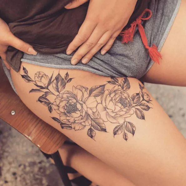 Peony tattoo on thigh by Tattooist Grain