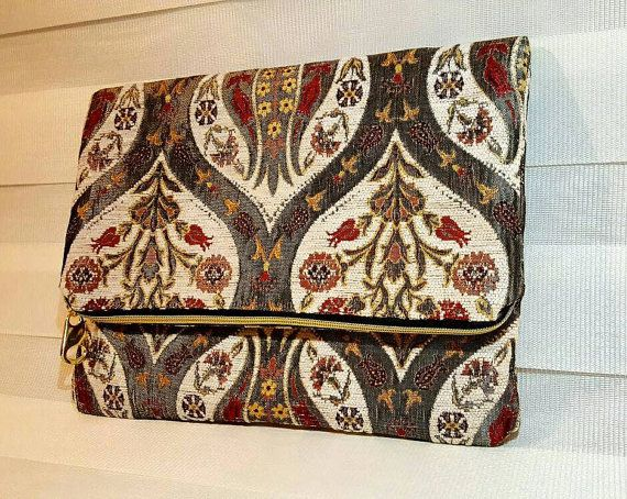 Check out this item in my Etsy shop https://www.etsy.com/listing/482641018/large-foldover-clutch-handmadefree-dust