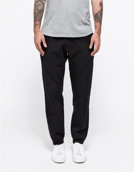 From Reigning Champ, a heavyweight french terry pant. Features off-seam front pockets, patch back pocket, gathered elasticized waistline with drawstring and ribbed cuffs.  •Heavyweight french terry pant •Off-seam front pockets •Patch back pocket