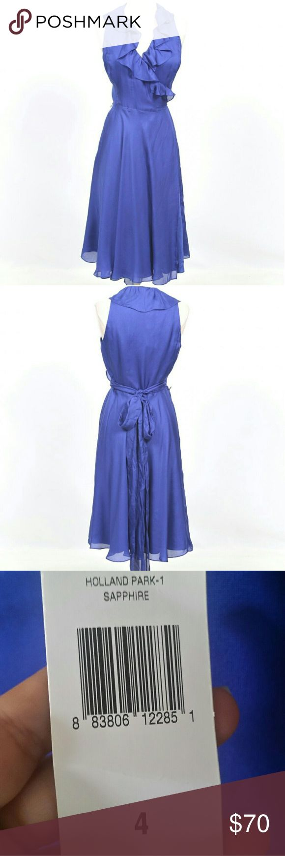 Ralph Lauren Wrap Dress Brand new with tags  Size 4 100% silk Gorgeous purple color  Perfect for a formal event or a date night out Ralph Lauren Dresses Midi