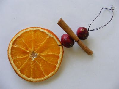 Dehydrated orange slice, fresh cranberries and cinnamon stick on thread.  Will look and smell beautiful on the Christmas tree.
