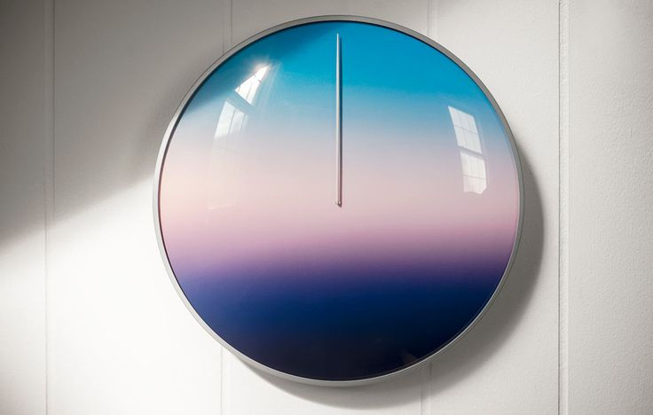 Today is a 24-hour clock that removes numbers and instead displays a gradient-like spectrum of the entire day, balancing dawn, noon, dusk, and midnight.