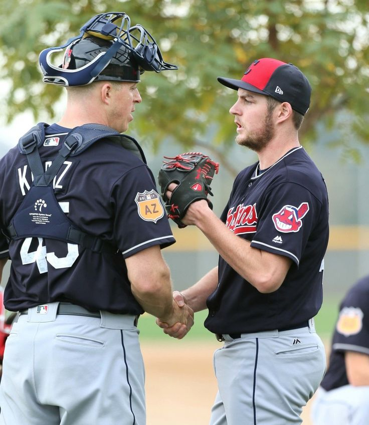 Cleveland Indians Trevor Bauer with catcher Erik Katz   after Bauer's bullpen session at spring training in Goodyear, Arizona on Feb. 17, 2017. (Chuck Crow/The Plain Dealer)