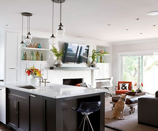 When planning cooking, eating, and relaxation stations, consider what you want to see from each area. Place your sink or cooktop in an island so as you work, you can enjoy a hearth's flickering flames, watch your kids as they play, talk with guests, and take in panoramas framed by doors or large windows in adjacent areas.