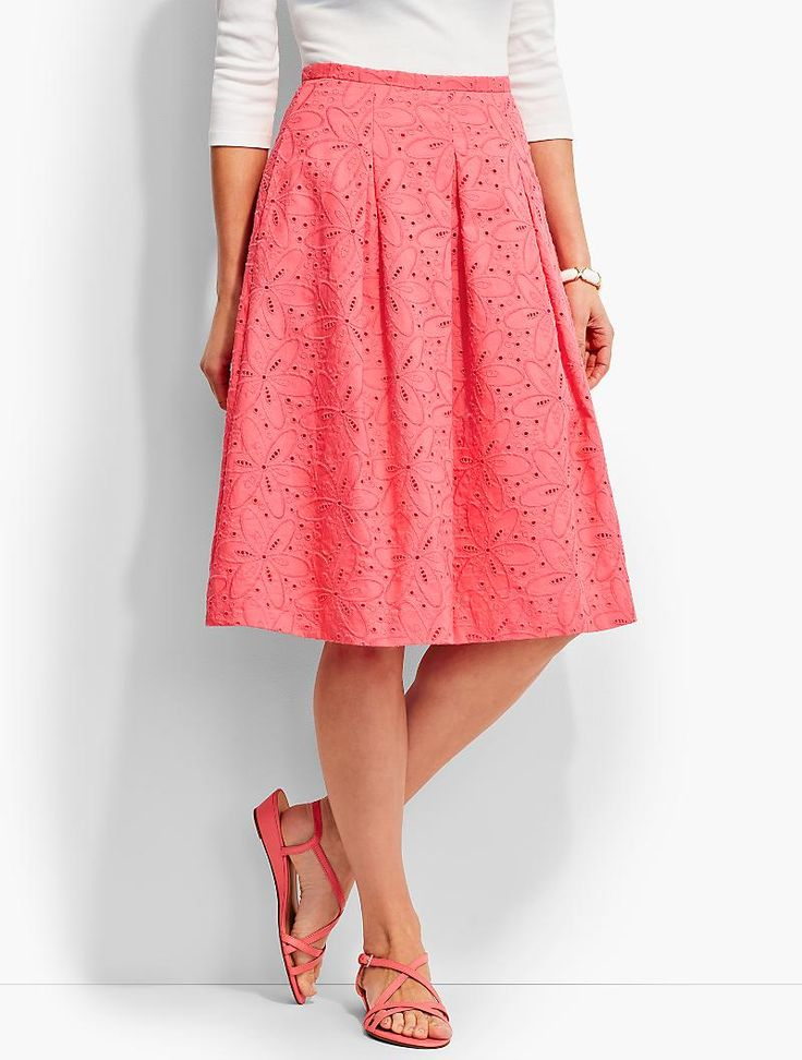A crisp cotton skirt with a comfortable fit, feminine flare and pleated front and back.