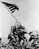 There are six Flag Raisers on the famous Iwo Jima photo. Four in the front line and two in back. The front four are (left to right) Ira Hayes, Franklin Sousley, John Bradley and Harlon Block. The back two are Michael Strank (behind Sousley) and Rene Gagnon (behind Bradley). Strank, Block and Sousley would die shortly afterwards. Click the picture to read more...