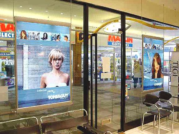 Illuminated Poster Display Suspended on Cables - Project consists of large format, low-voltage, edge-lit, poster light boxes suspended on a cable system. A great way to create stunning illuminated poster displays, and draw people into your office.