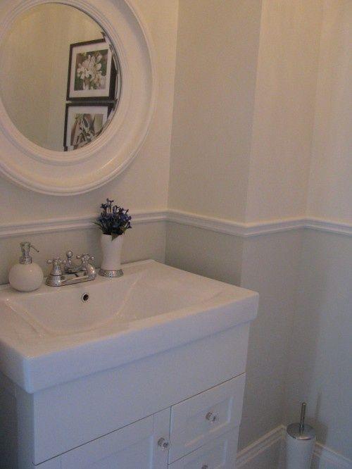 chair rail in bathroom- cheap detail and differentiates space...