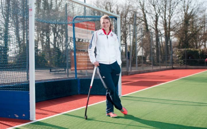 Lily Owsley standing on hockey pitch