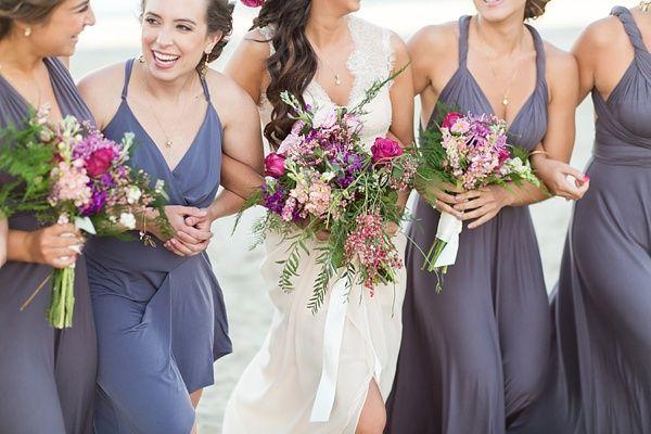 Bridesmaids in purple wedding dresses