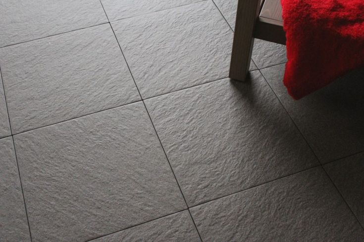 A Medium Sized Charcoal Grey Natural Stone Effect Floor Tile Made From Fully Vitrified