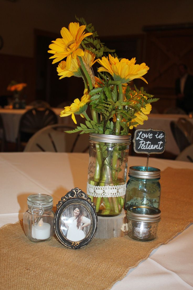 Centerpiece cedar wood block with mason jars milk bottles