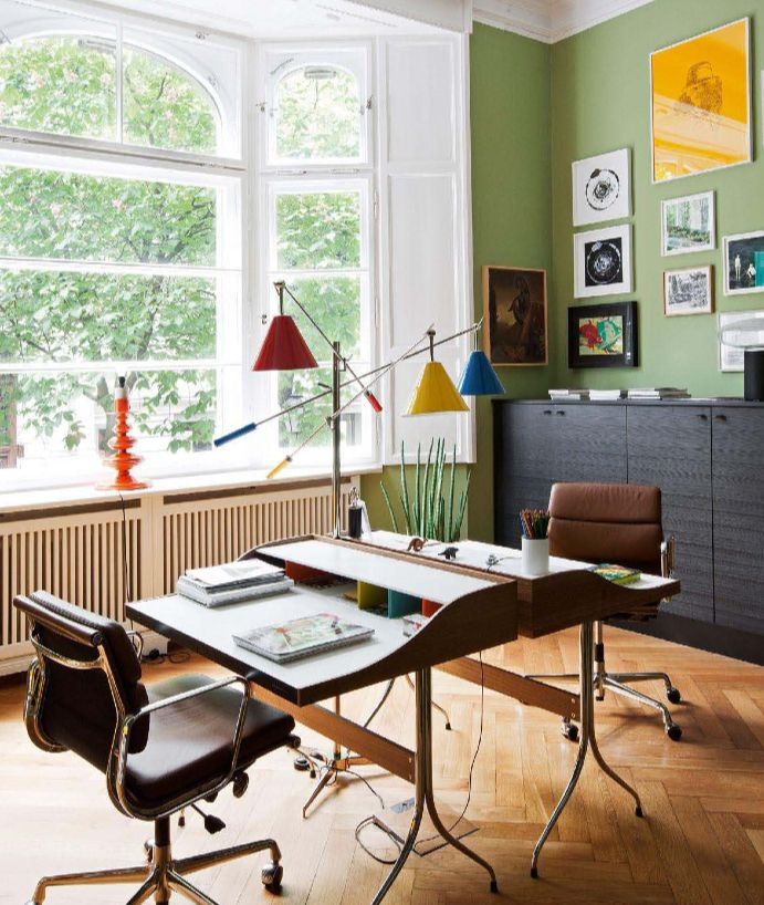 this awesome updated version of a mid century modern home office with eames chairs and george