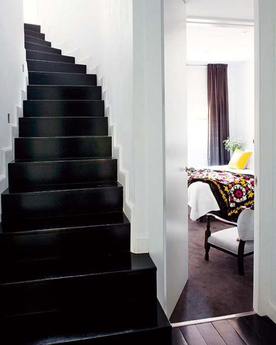 In an all white room painting the stairs black can create a moody elegance!