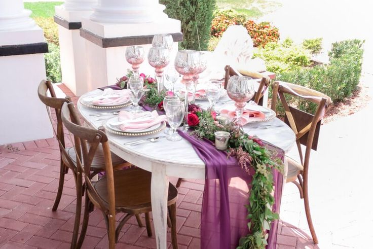 Reception table from a berry hued wedding inspiration
