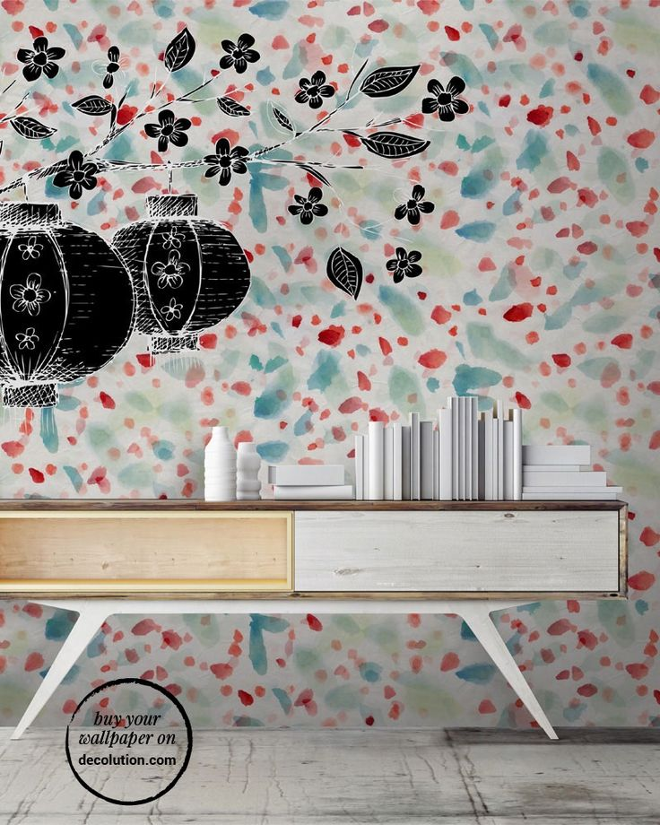 Lanterne - Chinese lanterns, unusually in black, stand out against a background of multicoloured petals drawn watercolour. A wallpaper to decorate the walls in  sober and delicate soft colours. www.decolution.com #wallpaper #cartadaparati #cartedaparati #papelpintado #papierpeint #tapete #wallcovering #designityourself #DIY #wallpapershop #wallpaperonline #wallcovering #interiordesign #homedecoration #home