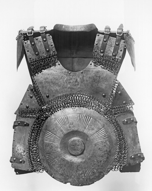 16th cent Turkey - reconstructed portion of full suit armor of Turkish soldier. The chain mail that links the circ breast & backplates to the steel plates @ sides & shoulders would have cont down over warrior's forearms & connect w/ plate coverings. soldier also may have been equip w/ plate leg guards or long skirt or trousers made of mail & reinforced w/ addit. steel plates. decor of the plates feature floral motifs, Arabic script (on back) & interlaced patterns used through Islamic hist…