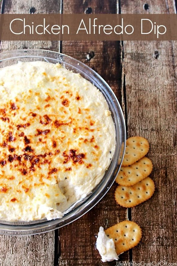 Chicken Alfredo Dip -3 cooked boneless chicken breasts, 8oz cream cheese, 1 jar alfredo sauce, 2 cups shredded mozzarella cheese, Grated Parmesan cheese