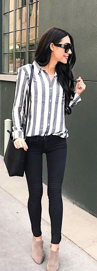 White and black striped collared button-up long-sleeved shirt and black skinny jeans carrying black shoulder bag. #Spring #Outfits