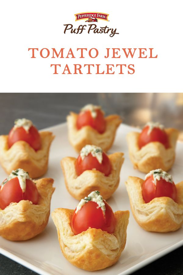 Puff Pastry Tomato Jewel Tartlets Recipe. These little bite-sized appetizers remind us of spring flowers ready to bloom. They'll look gorgeous on your Easter table and they're absolutely delicious. Cherry tomatoes are stuffed with a cheesy-herb filling, then tucked in Puff Pastry and baked to perfection in a mini-muffin pan. Also check out the alternate recipe option for making Sweet Berry Jewels with sweetened whipped cream and raspberries.