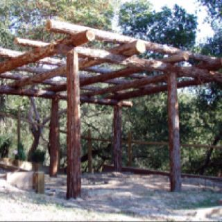 Rustic pergola. Want something similar on the side property.