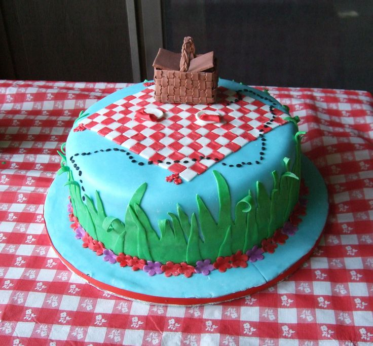 Picnic Theme Bridal Shower Cake - This was for my niece's bridal shower.  She had a picnic theme.  The cake is covered in fondant.  The picnic basket is handmade out of fondant.  Everything is edible.
