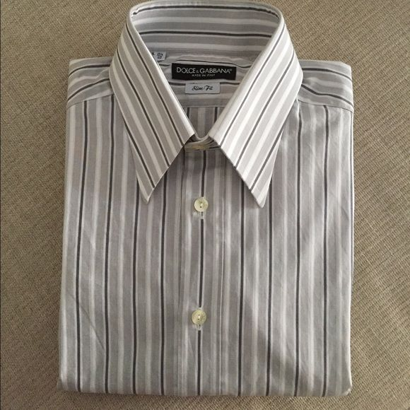 Dolce and Gabbana Men's long sleeve dress shirt slim fit made in Italy Dolce and Gabbana men's dress shirt. Size 15.5 us and 40 euro. Shirt is in a great condition and fits well on the body. Gray and white stripes. Dolce & Gabbana Tops Button Down Shirts
