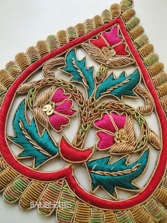 Close up of colourfull goldwork embroidery: paisley embellishment. Detail.