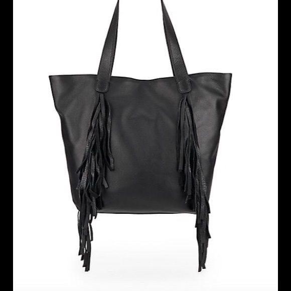 """NWT 🔶VINCE CAMUTO SHIRA FRINGED LEATHER TOTE Luxe """"Black"""" leather tote with boho-chic fringe     * Two top handles, 10"""" drop     * Top magnetic closure     * Front fringe detail     * Two inside open pockets     * One inside zip pocket     * One inside pen slot     * Fabric lining     * 19""""W at top X 14""""H X 4""""D Vince Camuto Bags Totes"""