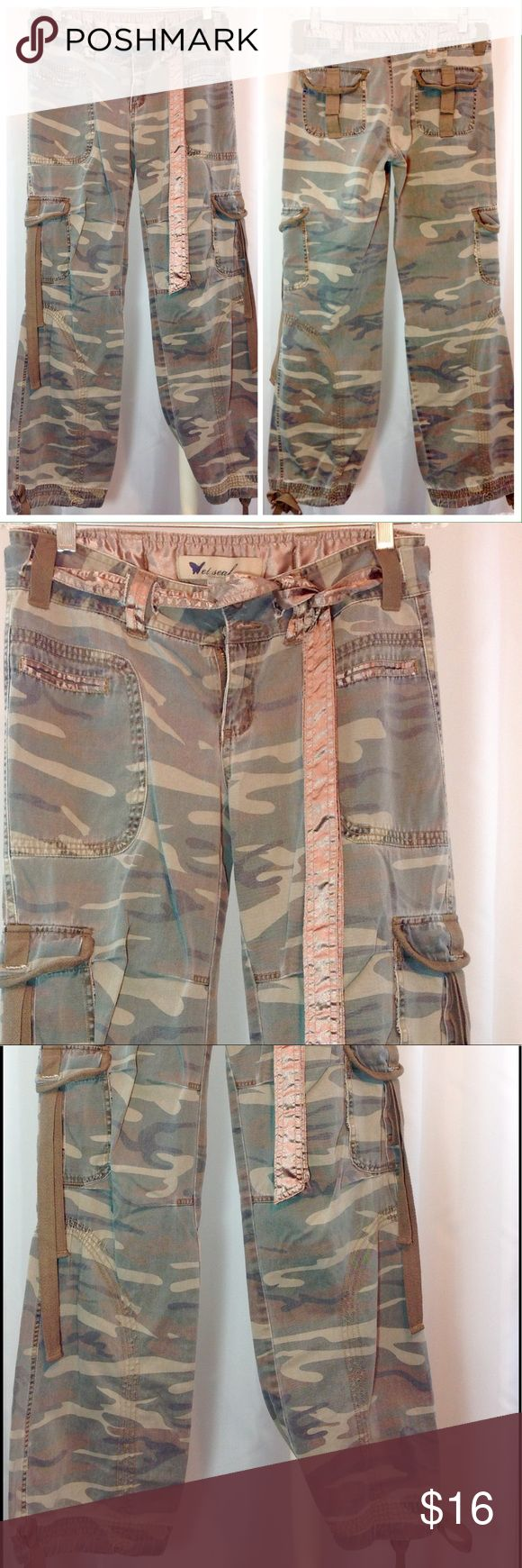 """Wet Seal Camo Cargo Style Ankle Pant Medium EUC Excellent condition! EUC. Camouflage cargo pant from wet seal. Lots of pockets, satin sash belt and satin trimmed hip pockets. Ankle and thigh pocket ties in cotton nylon. Great details! Size Medium. Waist 15""""across flat. Inseam 30"""".🔹Please ask all your questions before you purchase!  🔹Sorry, no trades or holds. 🔹Please use Offer Button! 🔹Bundle for your best prices! Wet Seal Pants Ankle & Cropped"""