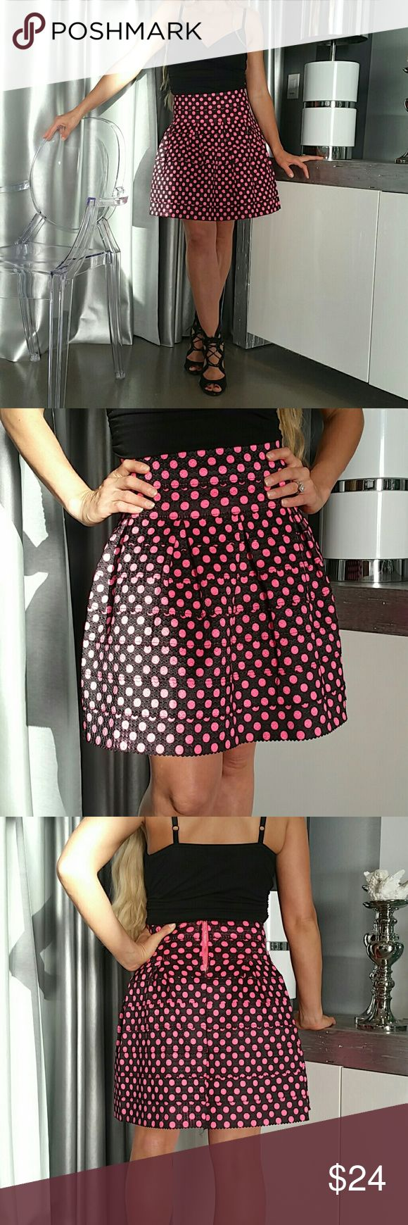 Gorgeous pink polka-dot skirt. NWT Honored Host Pick Brand new with tags.  Rows of black elastic with vibrant pink polka dots all over. Pair with a black top, blazer and heels or with a playful white top and booties with a denim jacket.   Zipper detail in back  Stretchy material. Overall length 18 inches  80% polyester 20% elastic  Vacation event special occasion a line party Skirts A-Line or Full