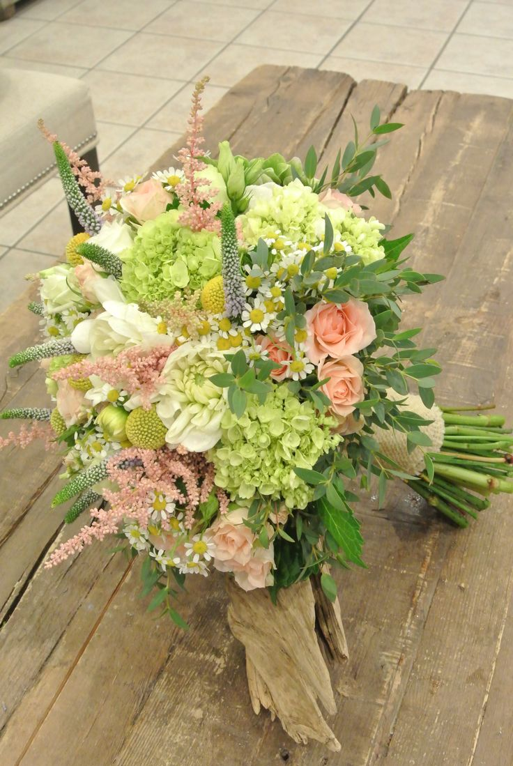 Bridal bouquet with hydrangea, astilbe, spray roses, craspedias, tanacetum, veronica, lisianthus and eucalyptus. Forget-Me-Not Flowers.