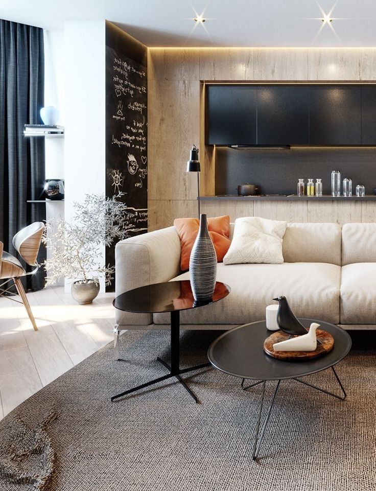 Your apartment's living room is a big design impact opportunity. Since your living room gets a lot of attention, using different textured walls like tile and chalkboard and having modern furniture pieces like this example are great design ideas that will