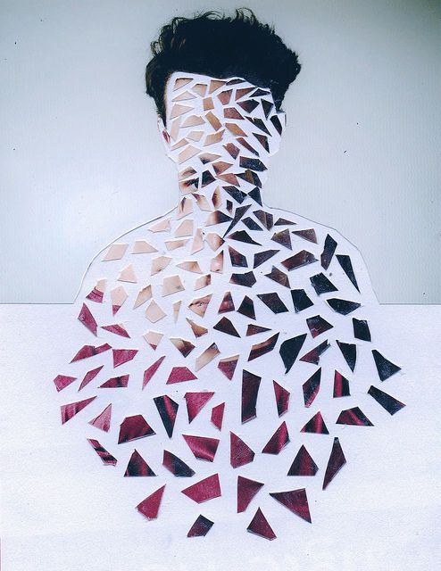portait- broken, cut into geometric shapes almost as if shattered vs the…