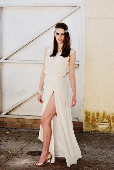 Wrap skirt with long split; Bridal Fashion, Sydneyl location. Photographed by Kent Johnson.