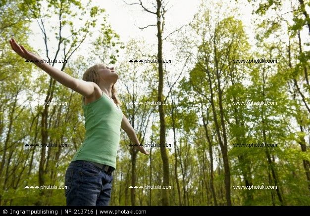 http://www.photaki.com/picture-young-man-standing-in-the-woods-enjoying-the-fresh-air-stretched-out-breathing_213716.htm