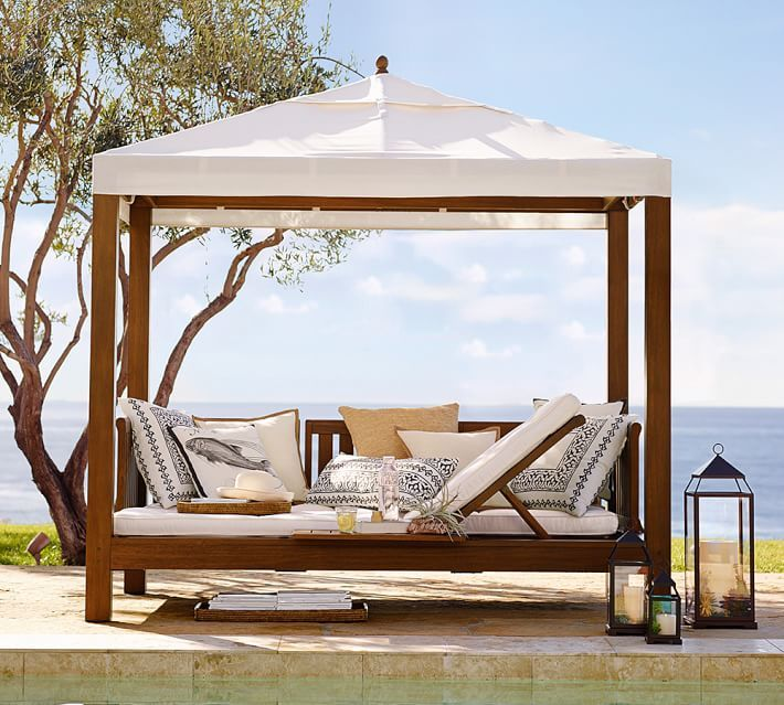 Bring the luxurious feel of a resort cabana to your for Outdoor cabana furniture